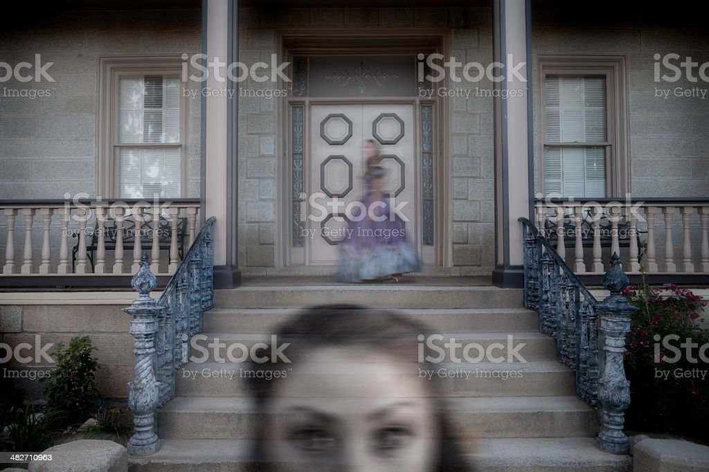 Frightening Ghost Outside a Mansion royalty-free stock photo