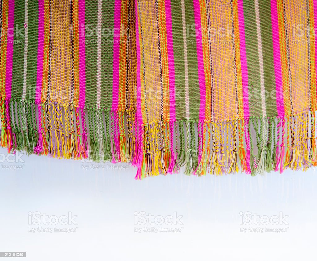 Fringe of a colorful rug as a background stock photo