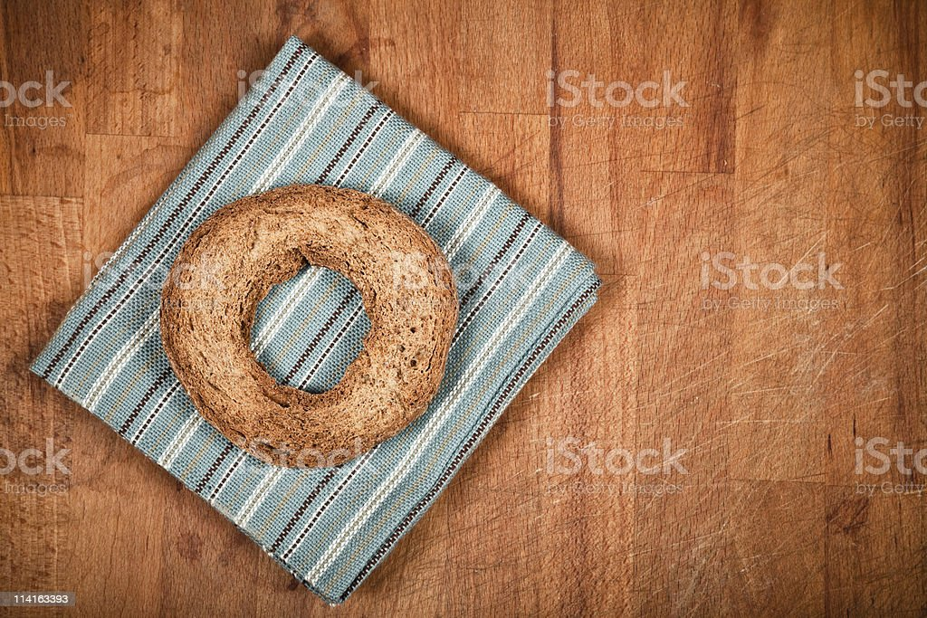 Frisa and napkins on chopping board stock photo