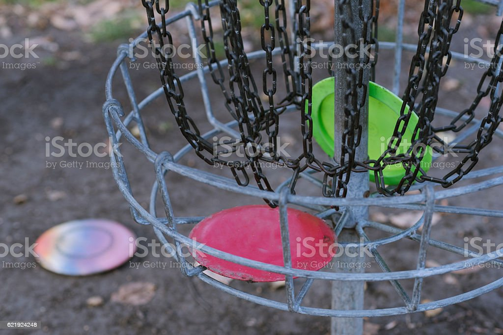 Frisbee golf basket close up with discs stock photo
