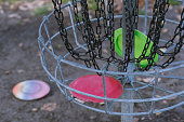 Frisbee golf basket close up with discs