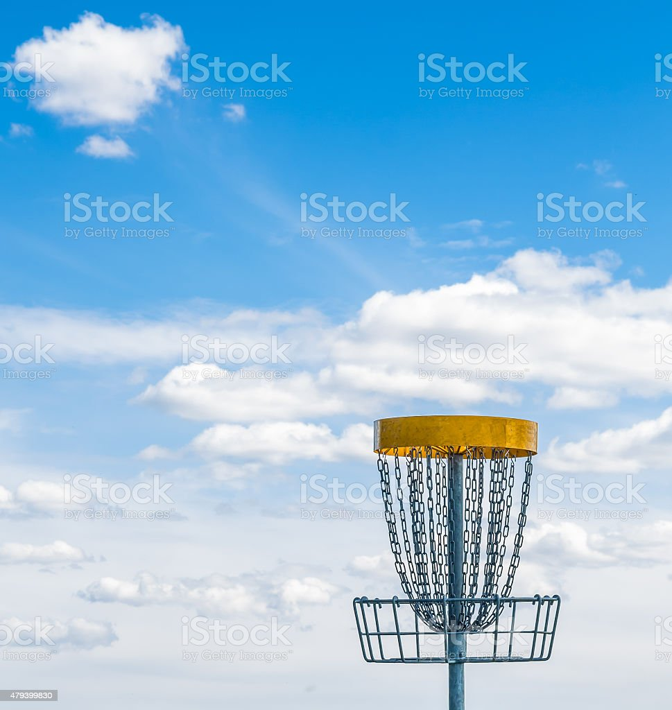 Frisbee golf basket on the grass stock photo