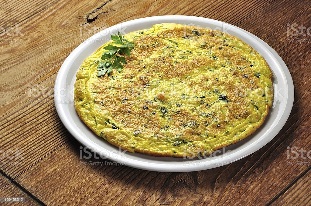 Frittata - italian omelette with parsley and parmesan royalty-free stock photo