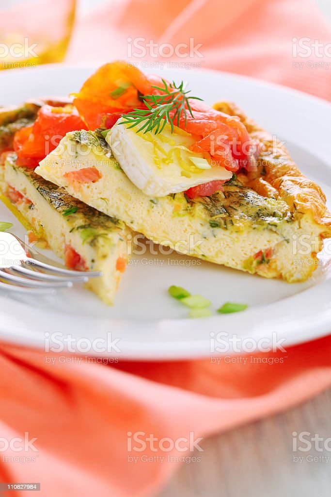 Frittata with salmon and camembert on white plate royalty-free stock photo