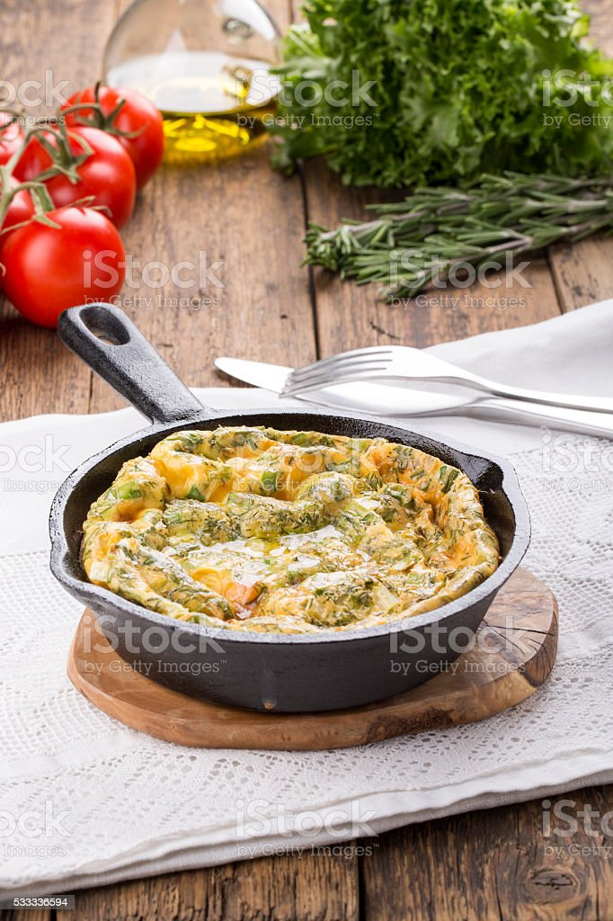 Frittata with salmon and herbs. stock photo