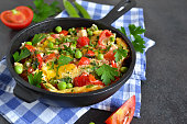 frittata with tomatoes, peppers, green peas and feta