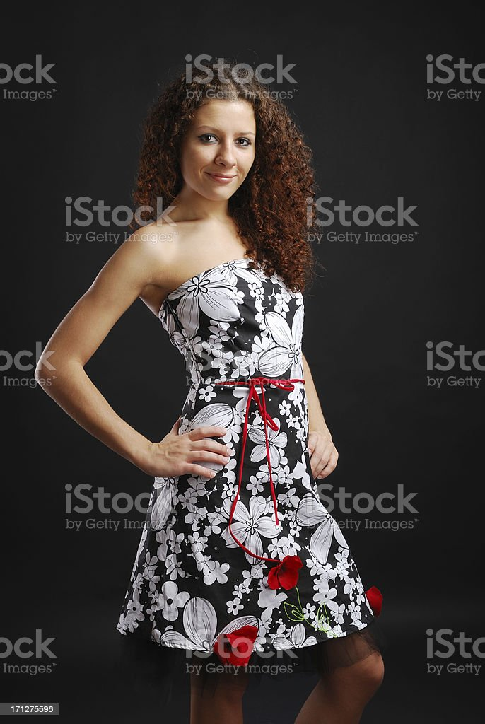 Frizzy girl in cocktail dress royalty-free stock photo