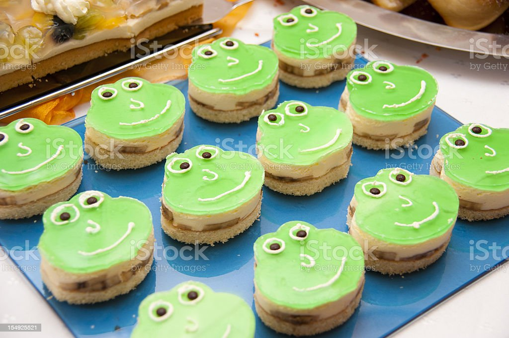 frog cake sweet on buffet stock photo