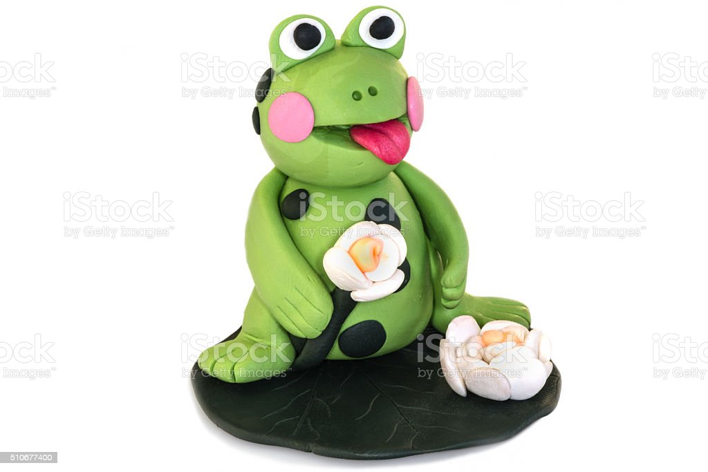 Frog figurine made of polymer clay on a white background stock photo