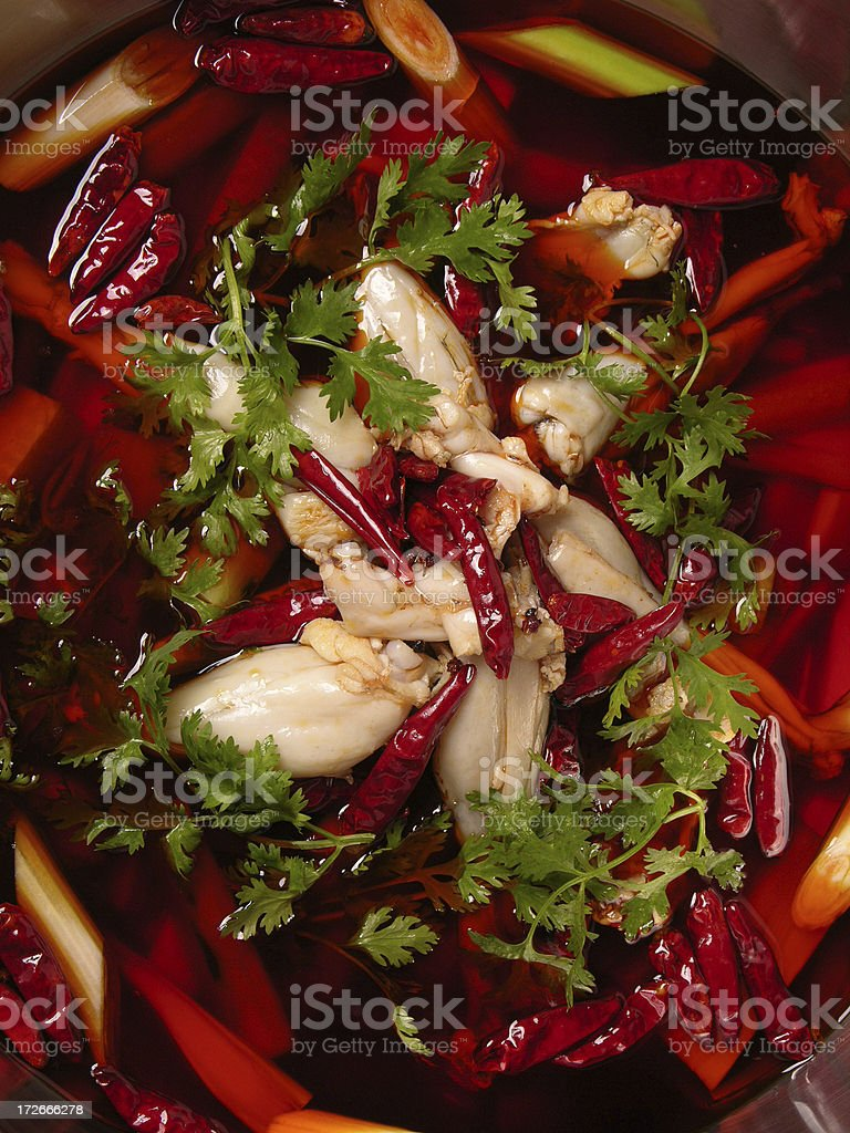 Frog legs in sharp flavor oil (Sichuan cooking, China) stock photo