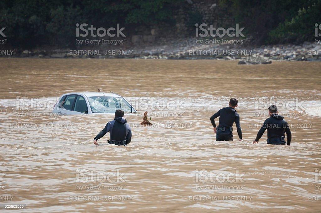Frogmen walking to sunken car stock photo