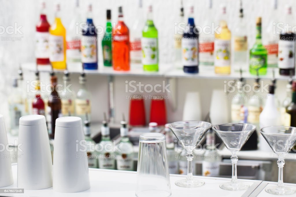 Front bar with glasses and shaker stock photo