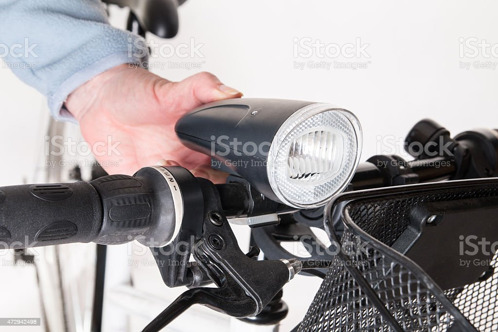 Front bicycle lamp on the steering whee stock photo