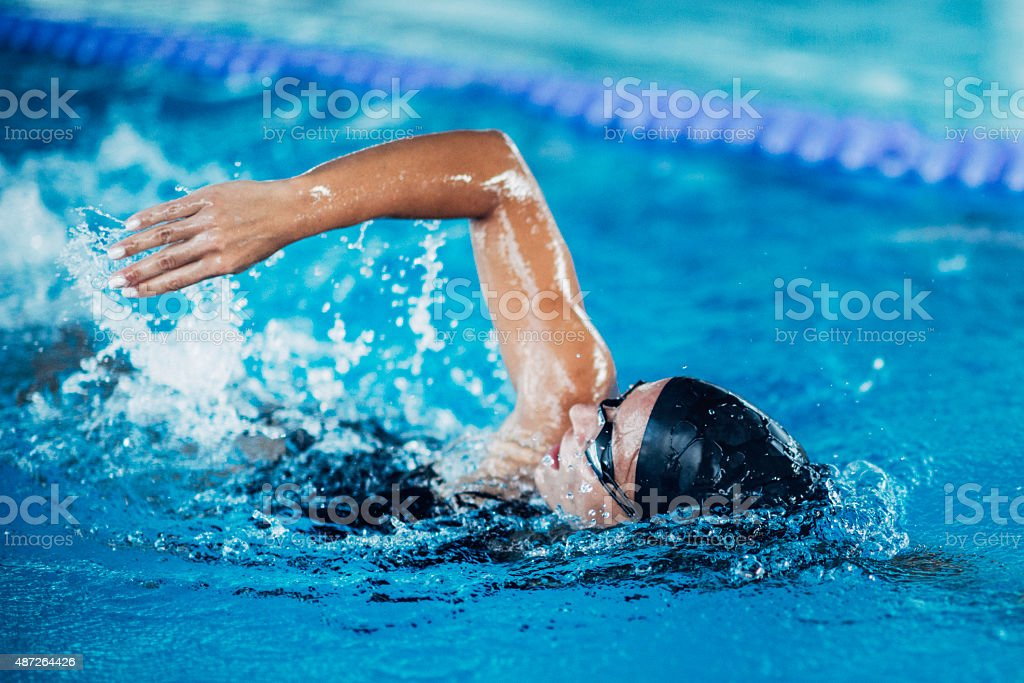 Front crawl swimmer stock photo