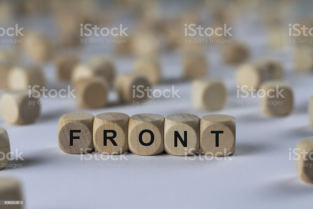 front - cube with letters, sign with wooden cubes stock photo