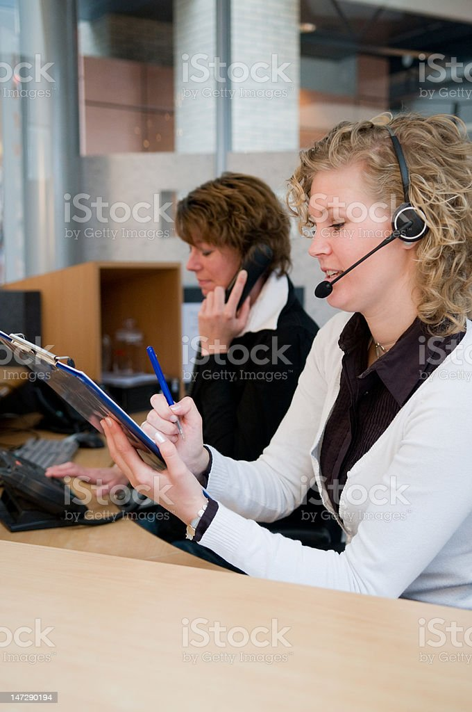 Front desk worker stock photo