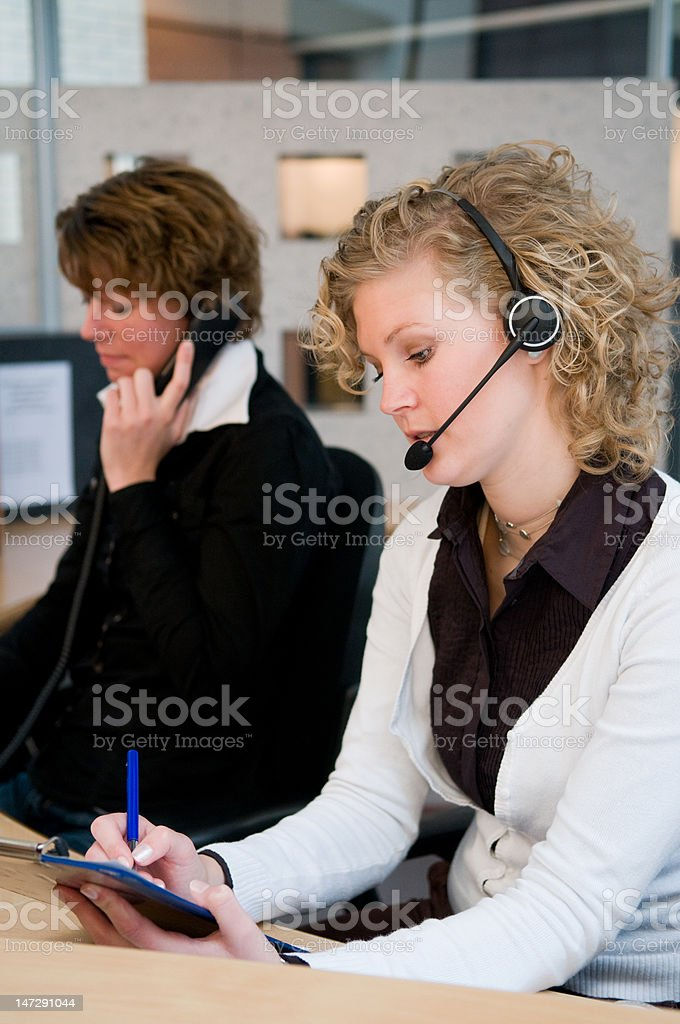 Front desk workers stock photo