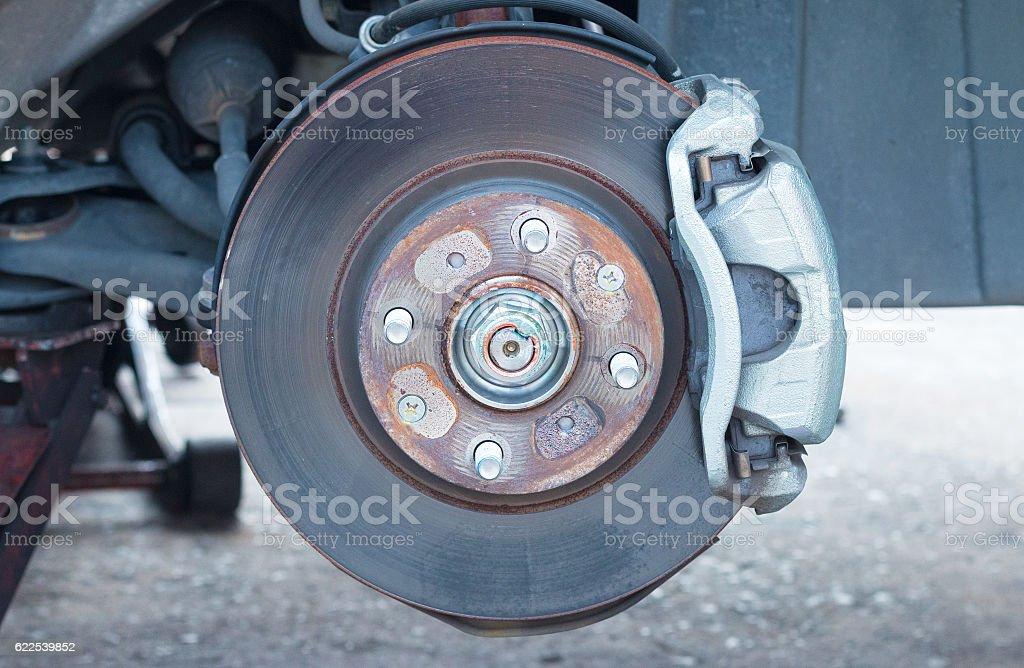 Front disc brake on car stock photo