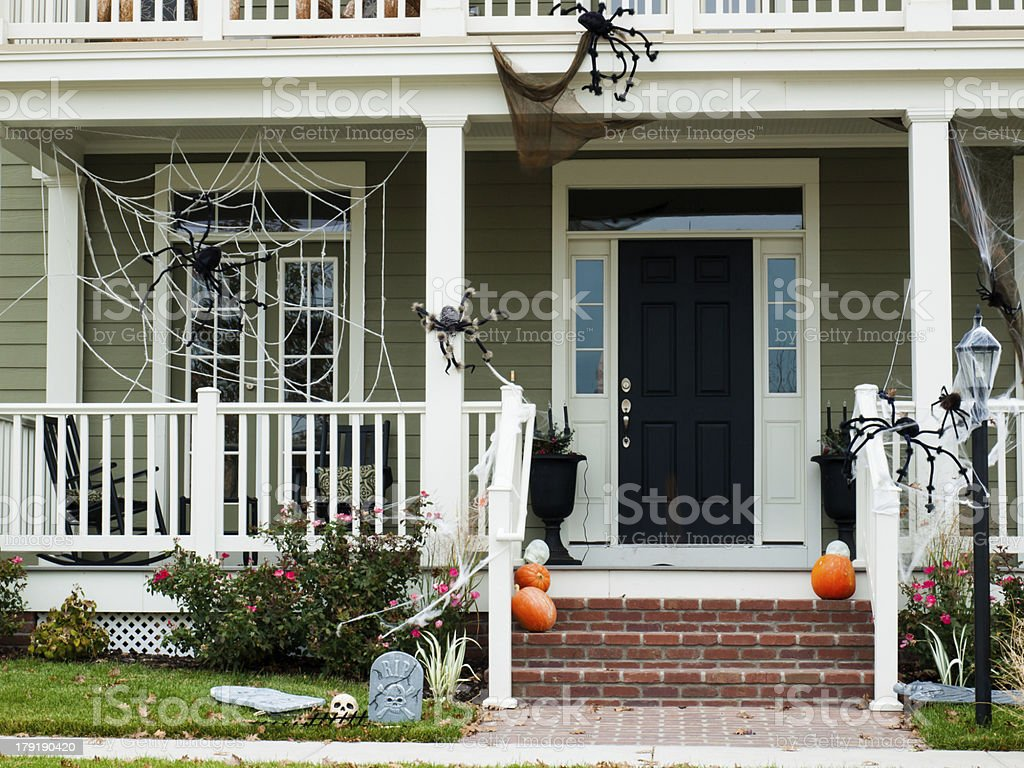 Front door decorated for Halloween stock photo