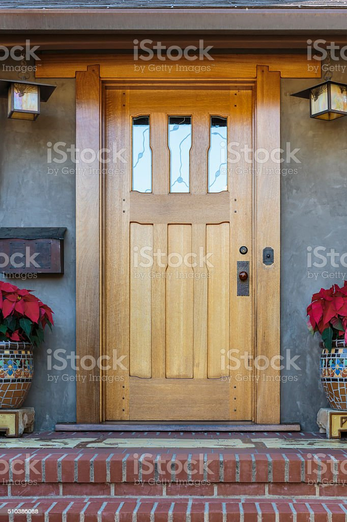 Front door, front view of brown door stock photo