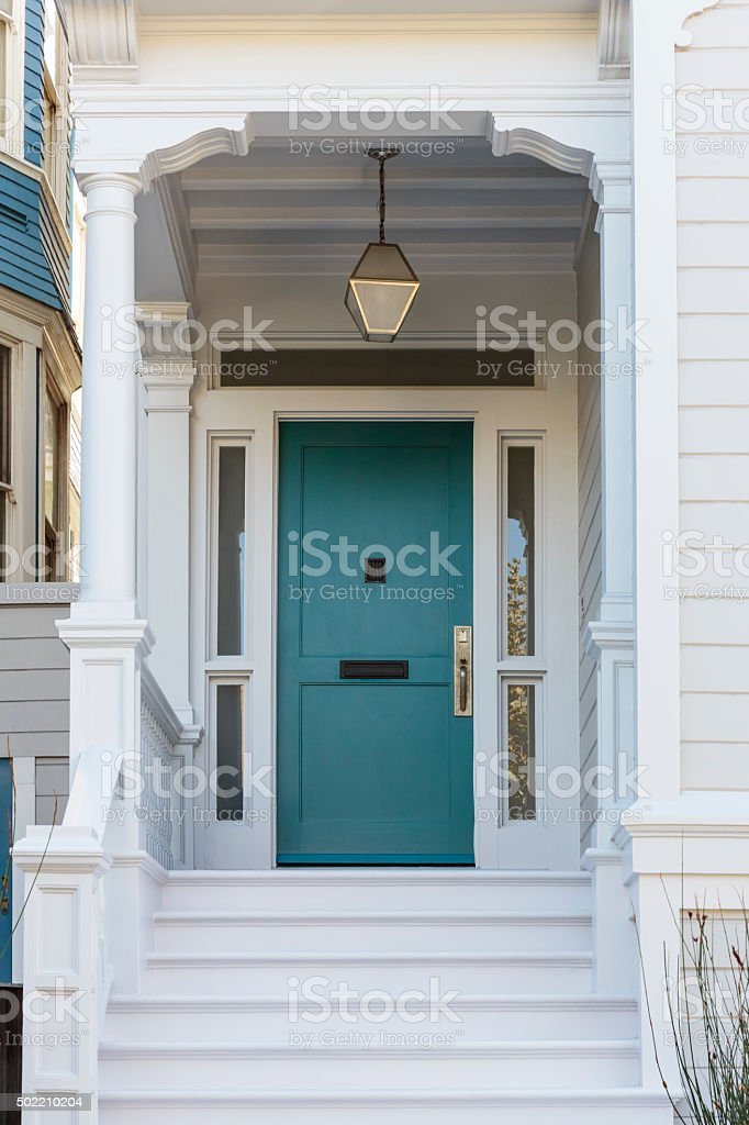 Front door, front view of front blue door stock photo