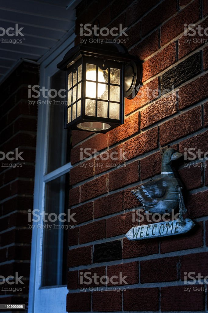 Front Door Lamp and Welcome Sign stock photo