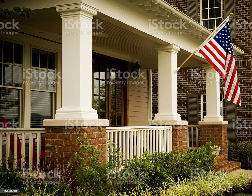Front Door of a Home with an American Flag stock photo
