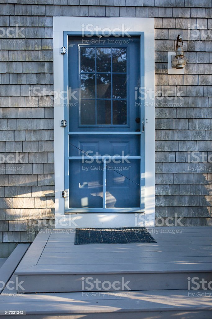 Front door of a house in Wellfleet, MA stock photo