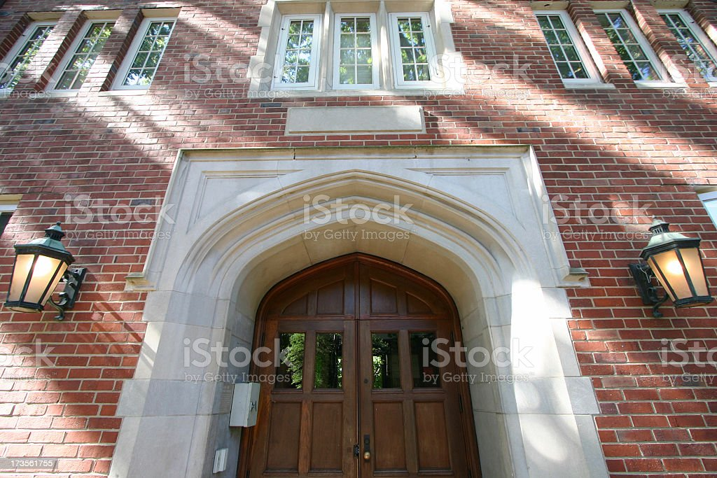 Front door of brick building on college campus royalty-free stock photo
