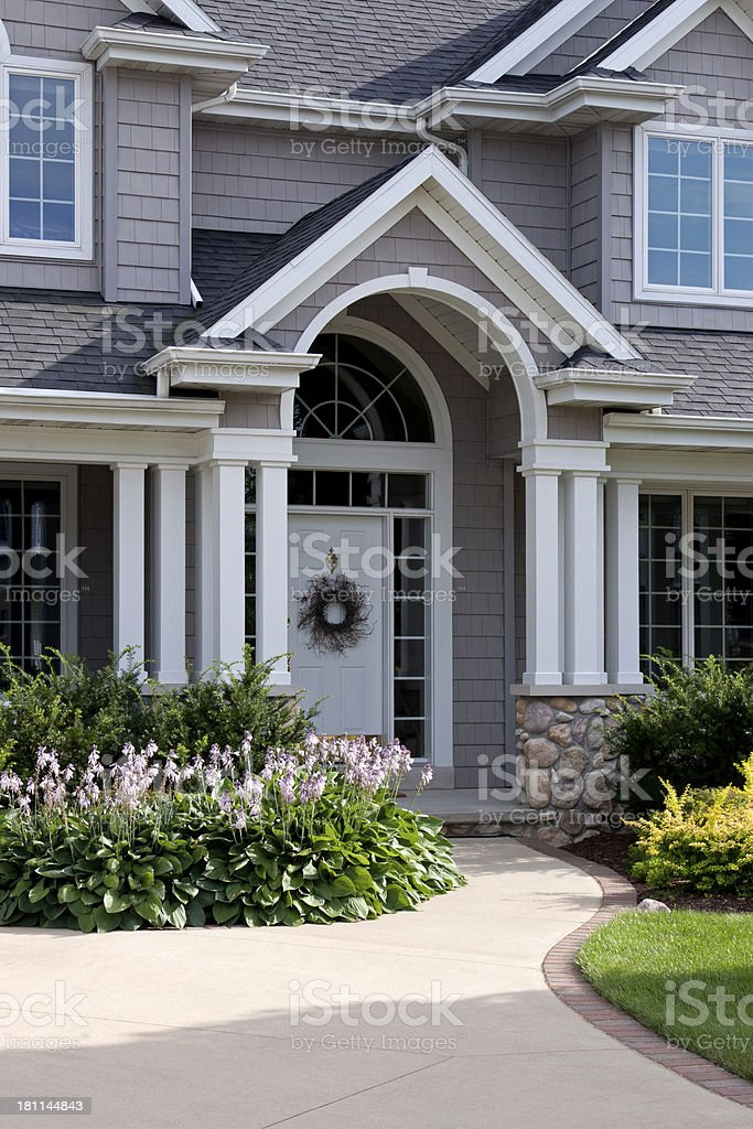 Front door of house with arch royalty-free stock photo
