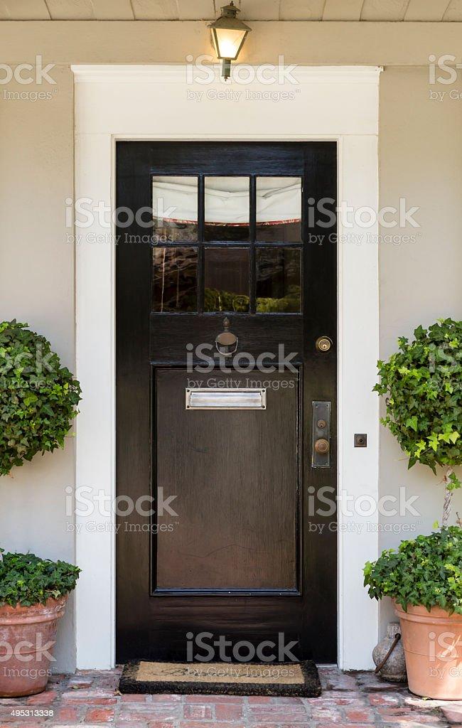 front door slim dark wood stock photo