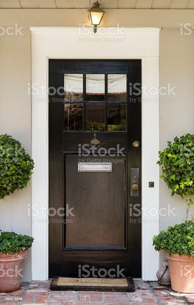 front door slim dark wood stock photo