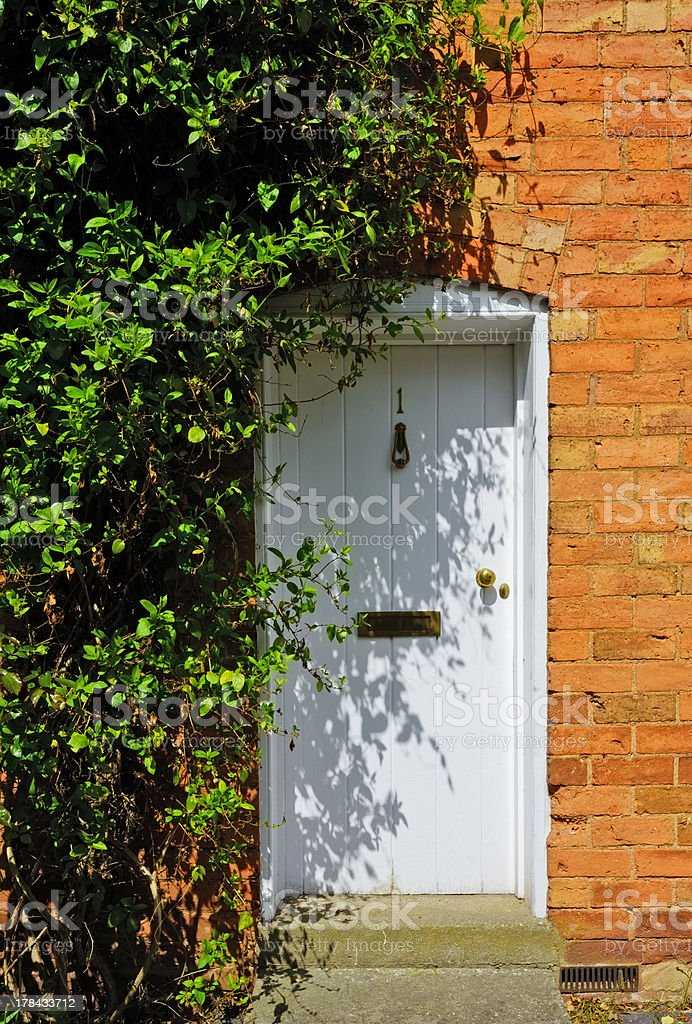 Front door to an old cottage in the UK royalty-free stock photo