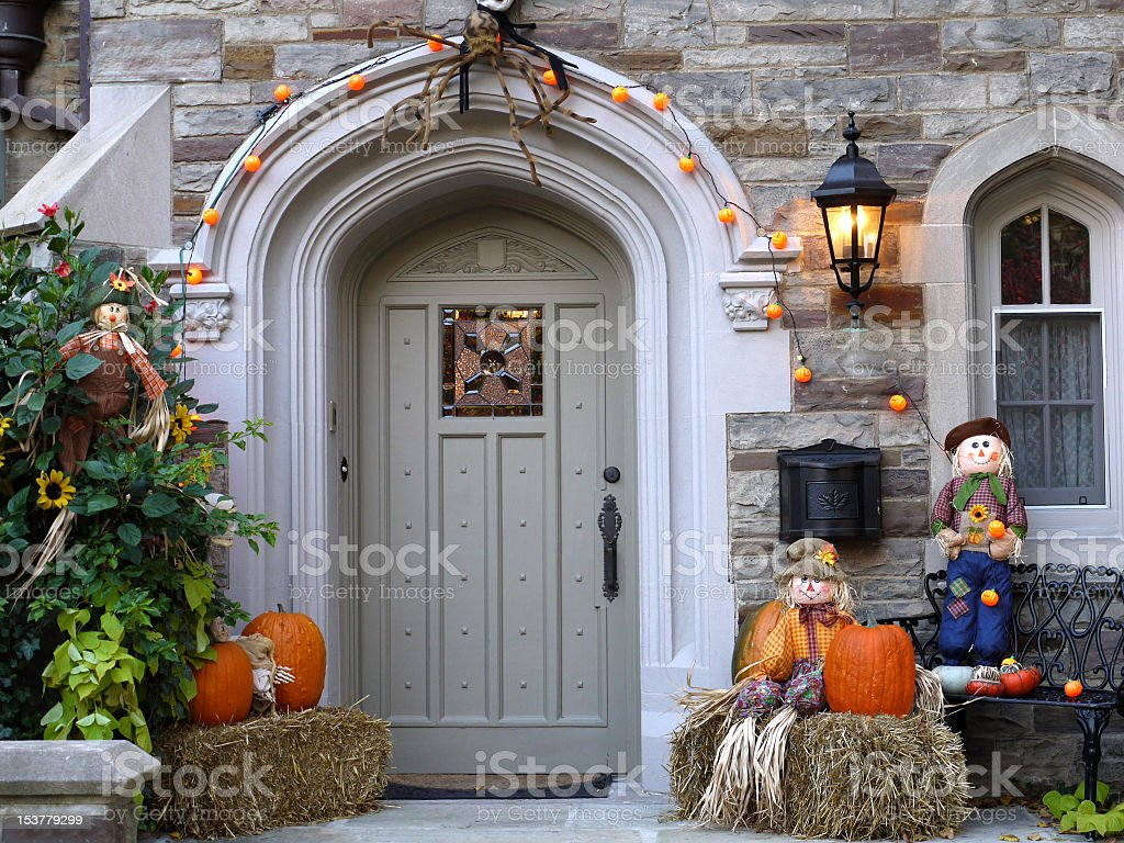 Front door with Halloween decorations at sunset stock photo
