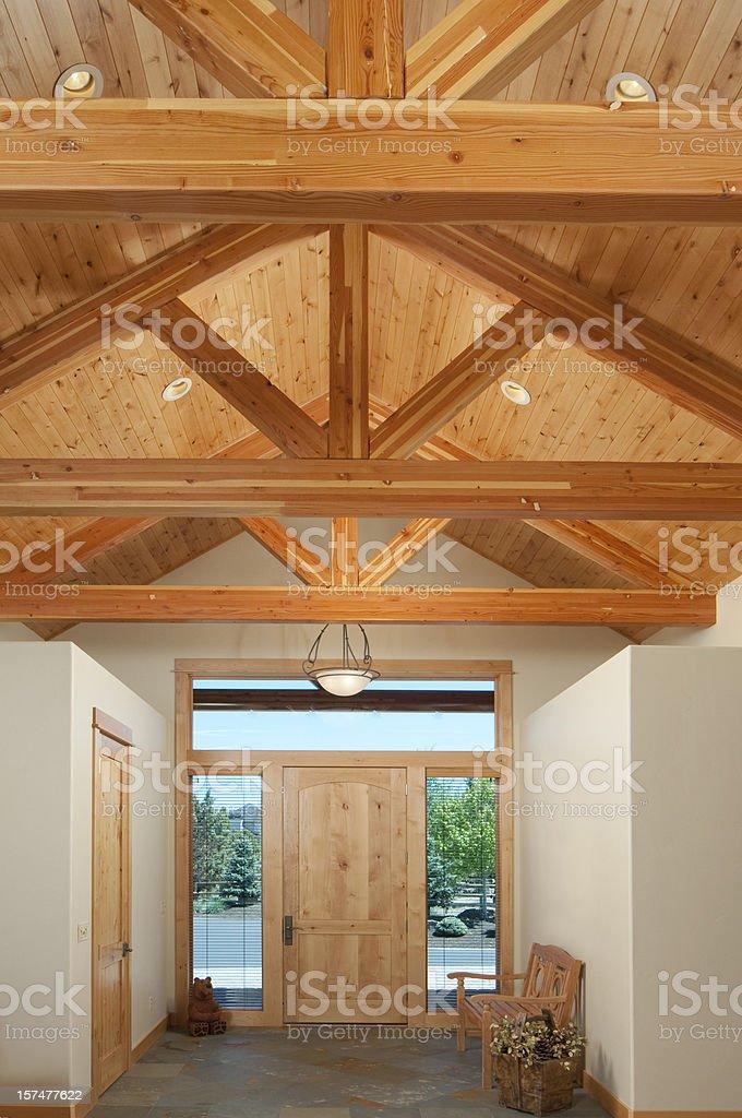 Front door with wood beam trusses stock photo
