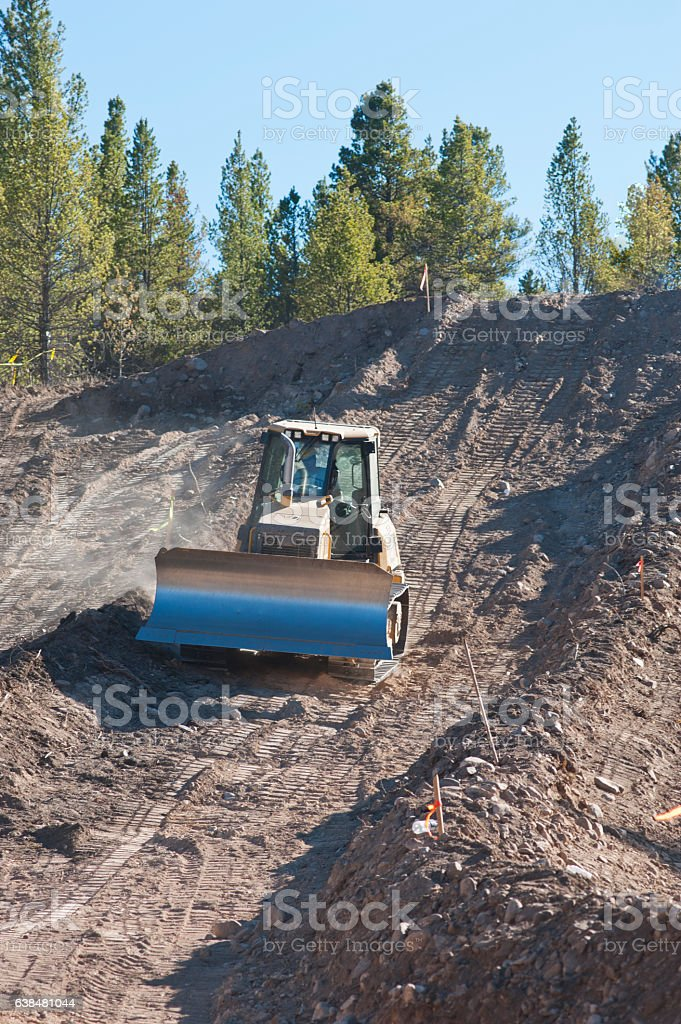 Front End Loader Building a Tubing Hill stock photo