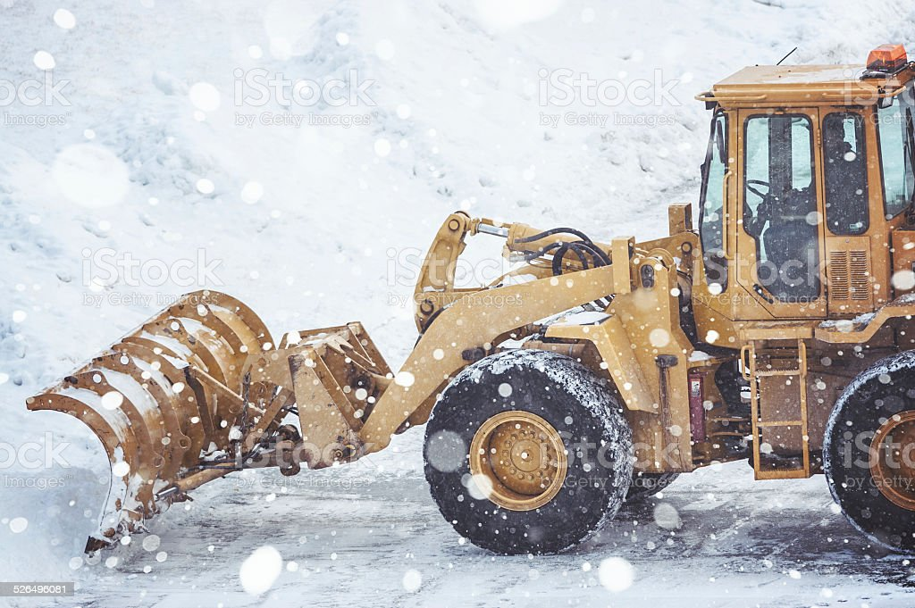Front End Loader Clears Parking Lot stock photo
