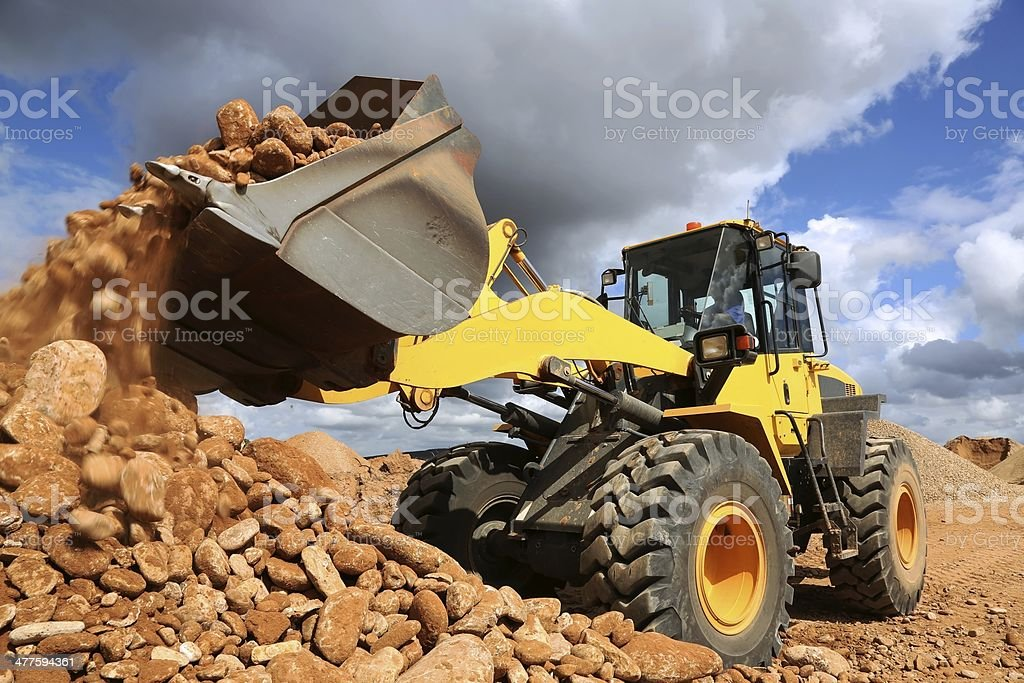Front End Loader Tipping Stone stock photo