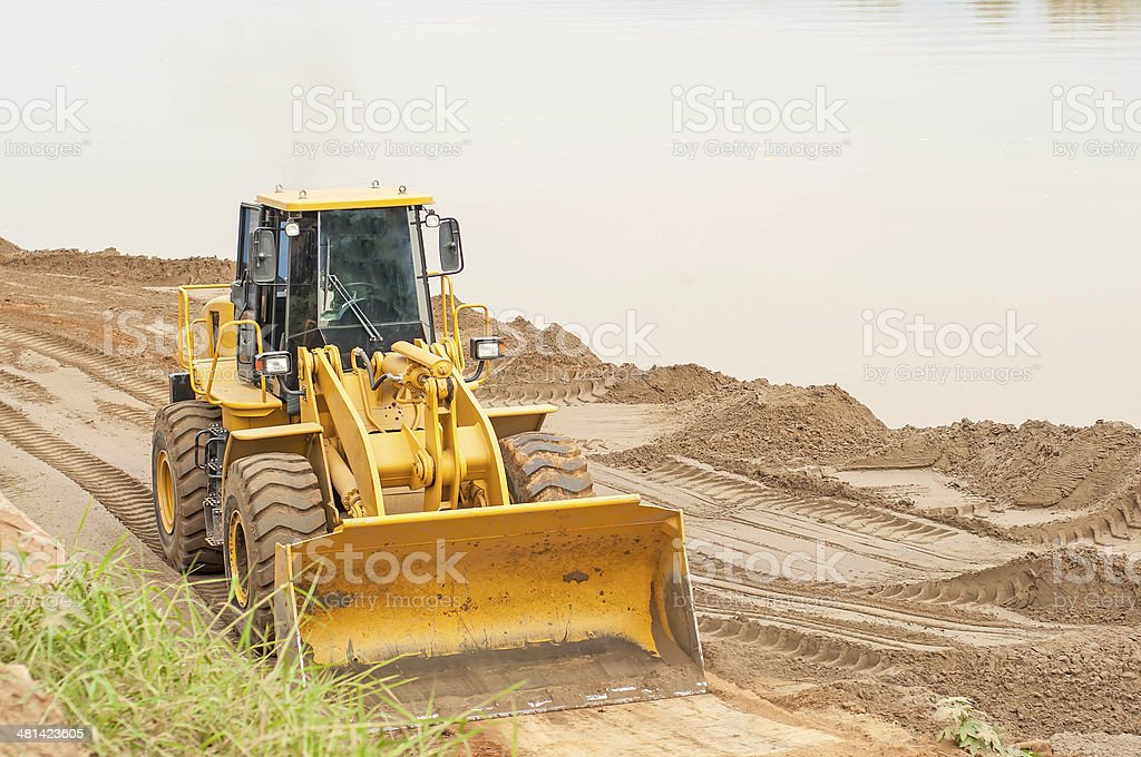 Front end loader working on the waterfront. royalty-free stock photo