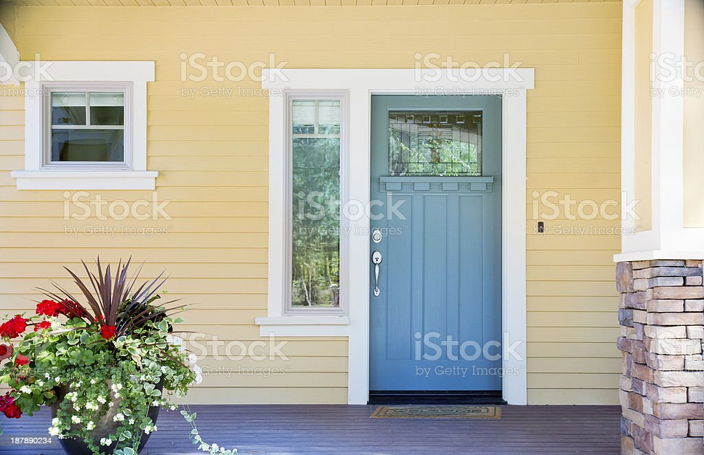 Front entrance of a home with blue door stock photo