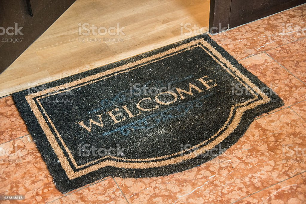 front entrence welcome doormat stock photo