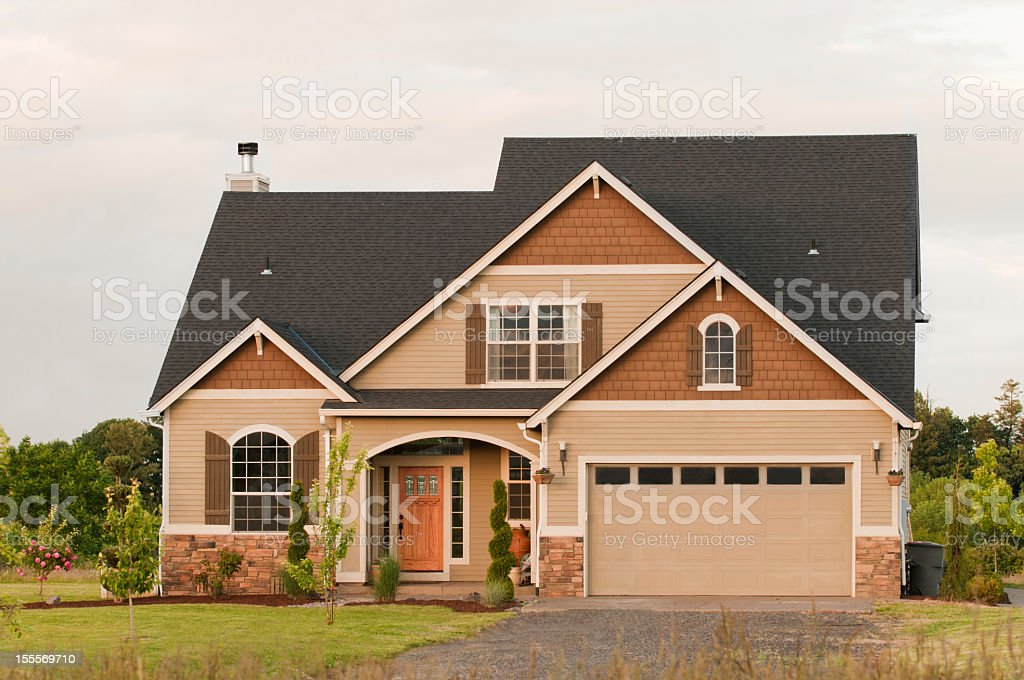 Front exterior of two story house with garage stock photo