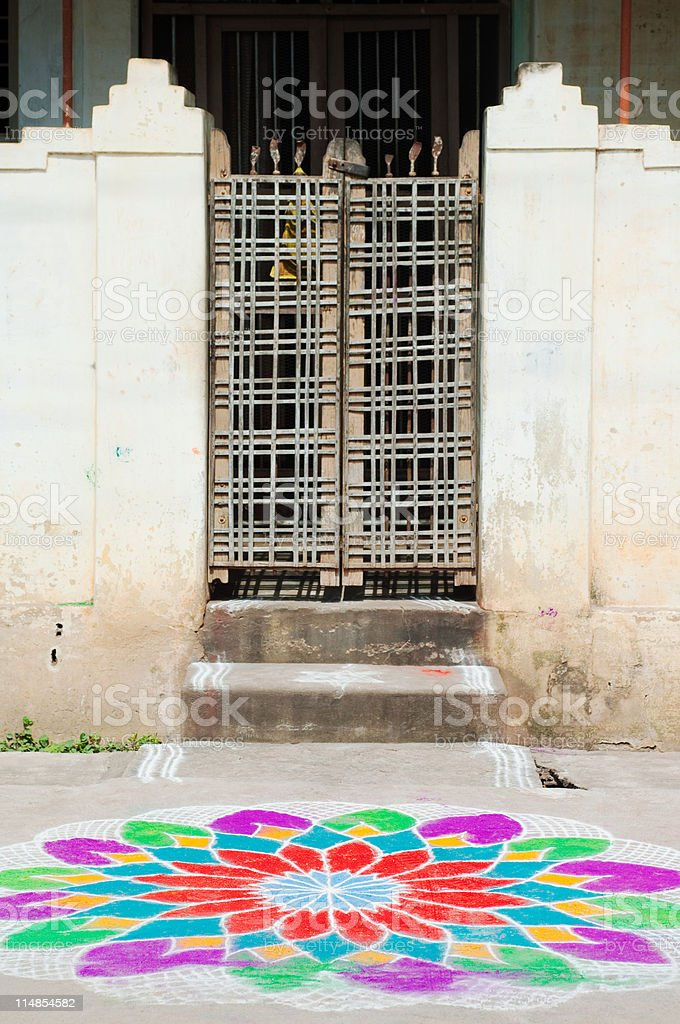 Front gate and colourful chalk flower on street, Trichy, Tamil Nadu stock photo