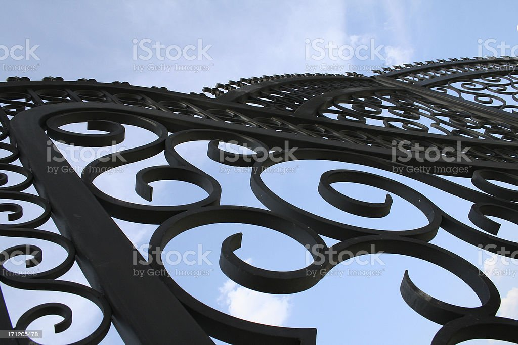 Front Gate With Swirls And Scrolls Around It stock photo