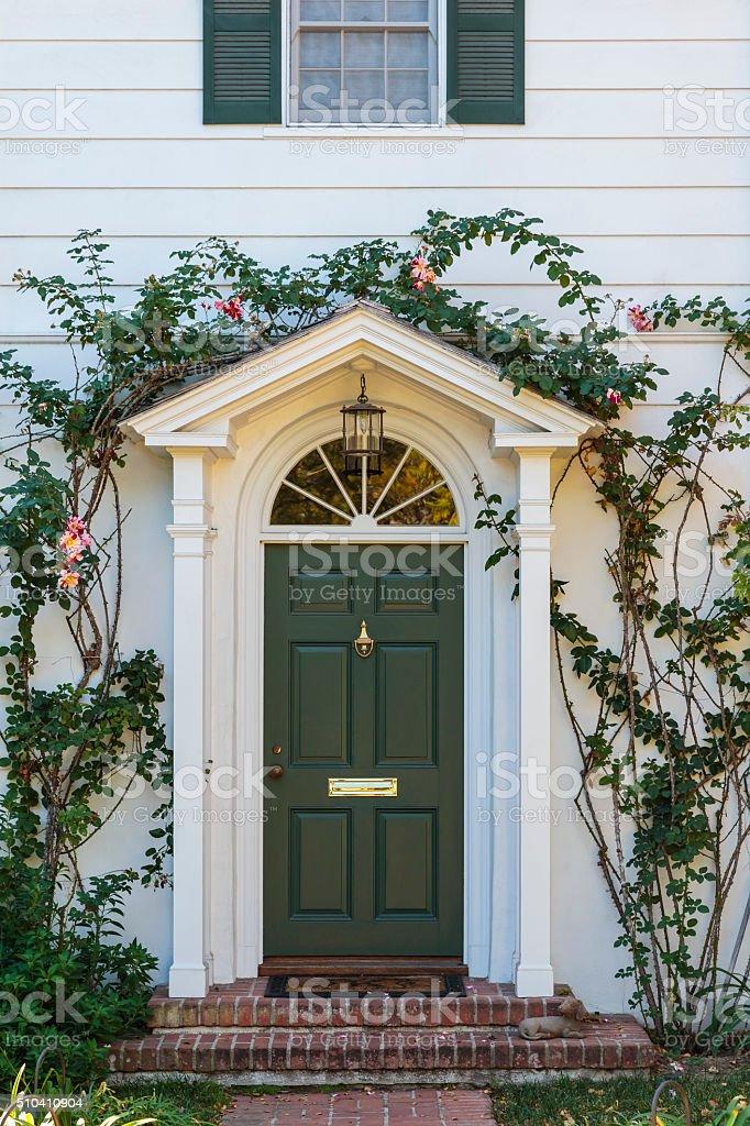 front green door with ivy stock photo