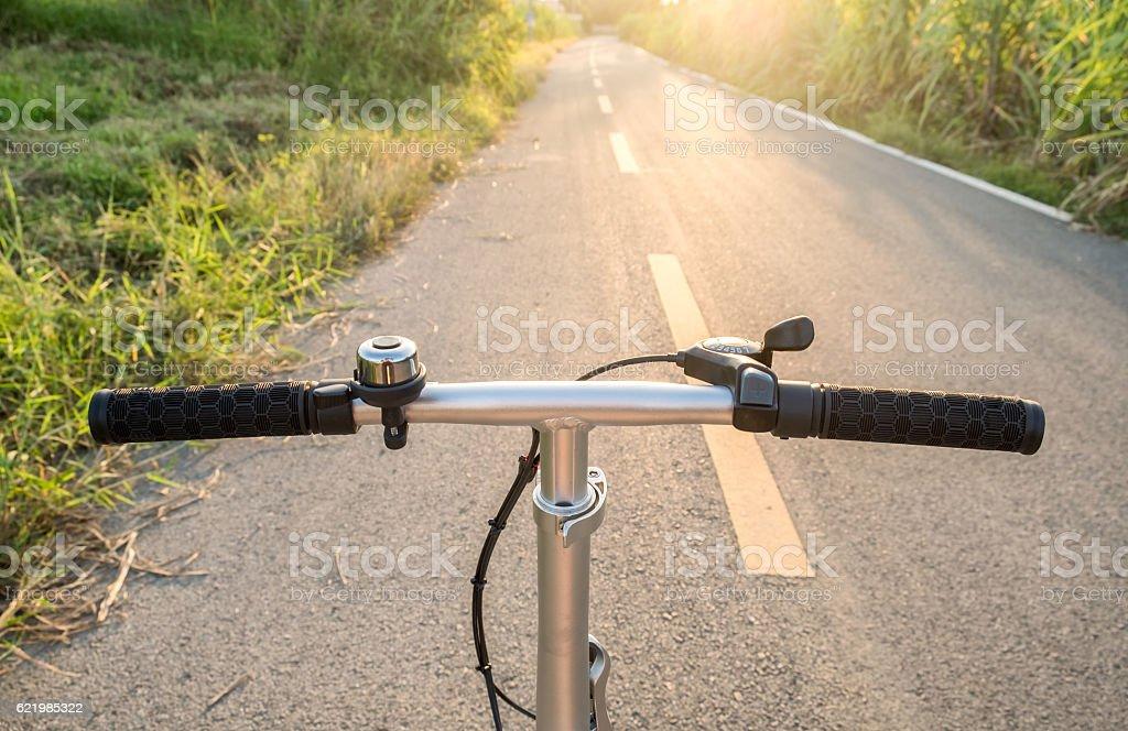 Front handle bar stem biking on rural road stock photo