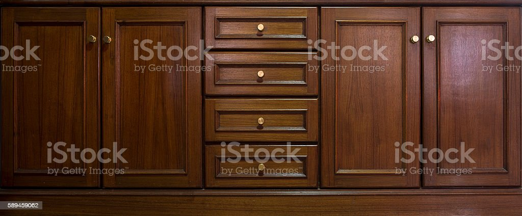 Front kitchen wooden frame cabinet door and drawers stock photo