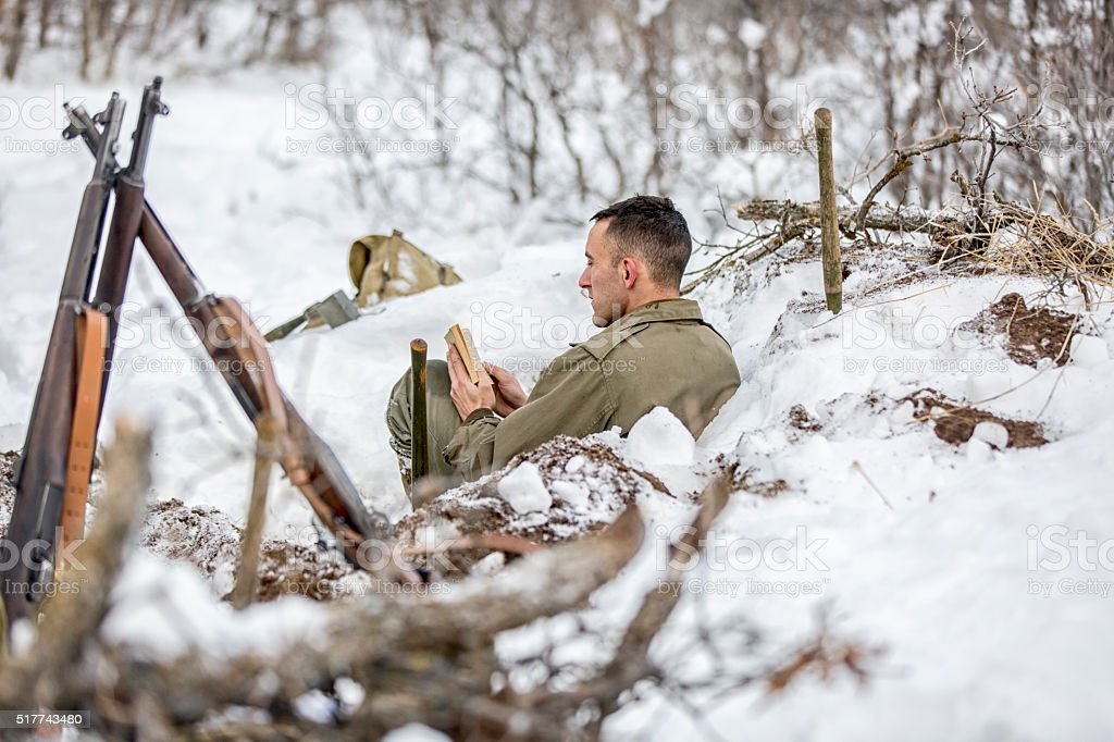 WW II: Front Lines in the Snow Bible and Rifles stock photo
