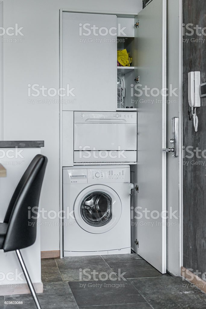Front load washer with open closet in modern home interior stock photo