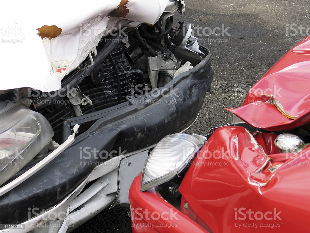 Front of a red car and the front of white car smashed up stock photo